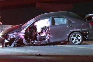 A woman was extracted from her car after she crashed on the Gulf Freeway exit ramp to the South Loop on Wednesday, Sept. 19, 2018.
