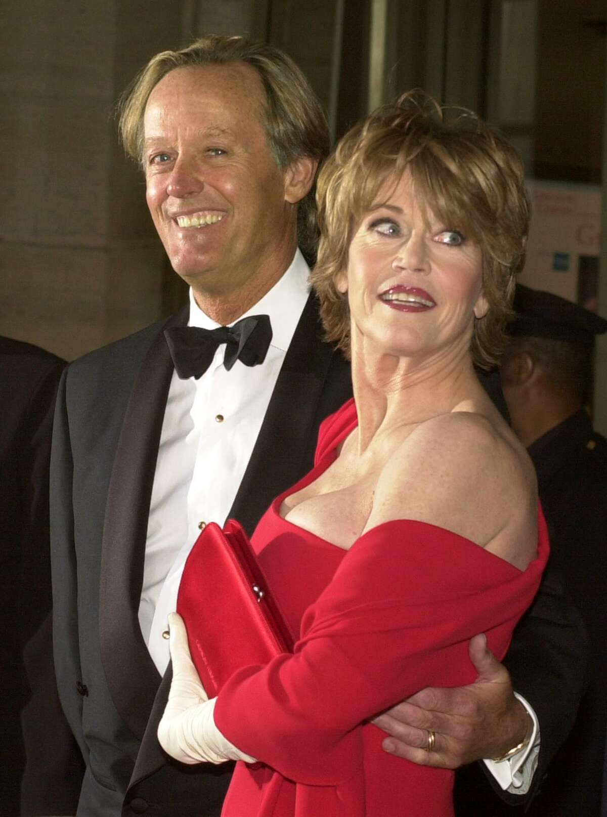 Actress Jane Fonda pauses for photographers with her brother, actor Peter Fonda, as the pair arrives for the Film Society of Lincoln Center tribute in her honor, Monday, May 7, 2001, in New York.