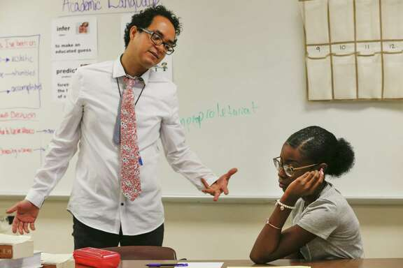 """Cesar Cano, a teacher at Pasadena Memorial High School and is also a finalist on FOX's """"MasterChef, gives positive reinforcement to Mea Randall Monday, Sept. 17, 2018, in Houston."""