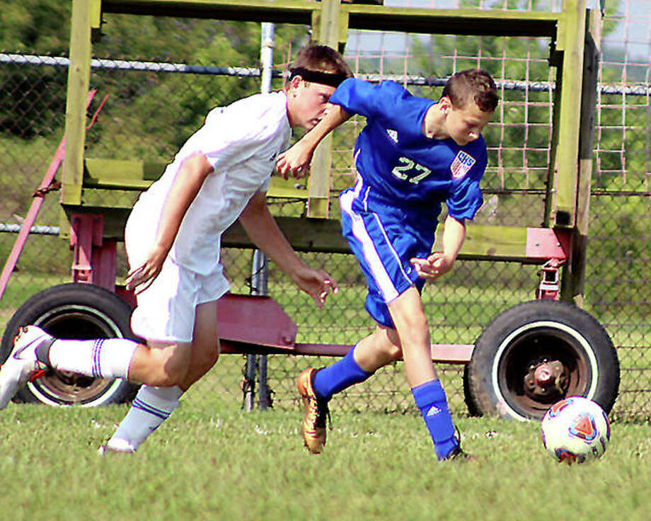 Carlinville's Levi Yudinsky, right, scored two goals and helped the Cavies top a 4-0 SCC victory over Hillsboro Tuesday night at Loveless Park. Yudinsky is shown in action earlier this season against EA-WR. Photo: Pete Hayes | The Telegraph