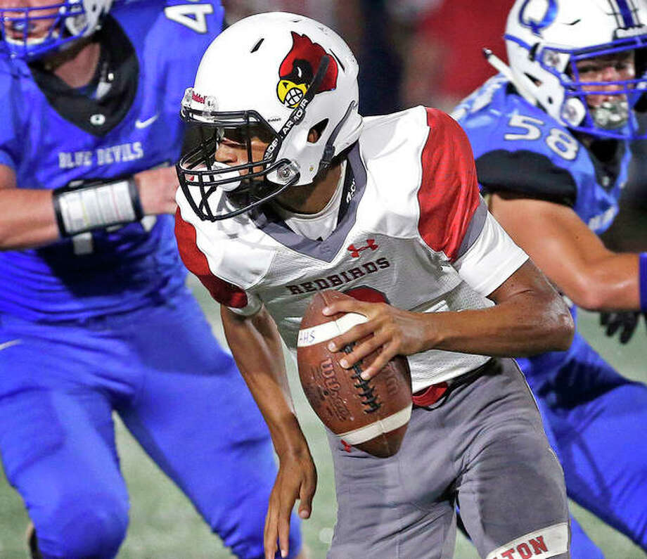 Alton quarterback Andrew Jones threw a pair of touchdown passes in the Redbirds' loss to Belleville West Friday. Alton will play at Edwardsville this Friday at 7 p.m. at the District 7 Sports Complex. Jones is shown in action earlier this season against Quincy. Photo: Jakes Shane, Quincy Herald-Whig | For The Telegraph
