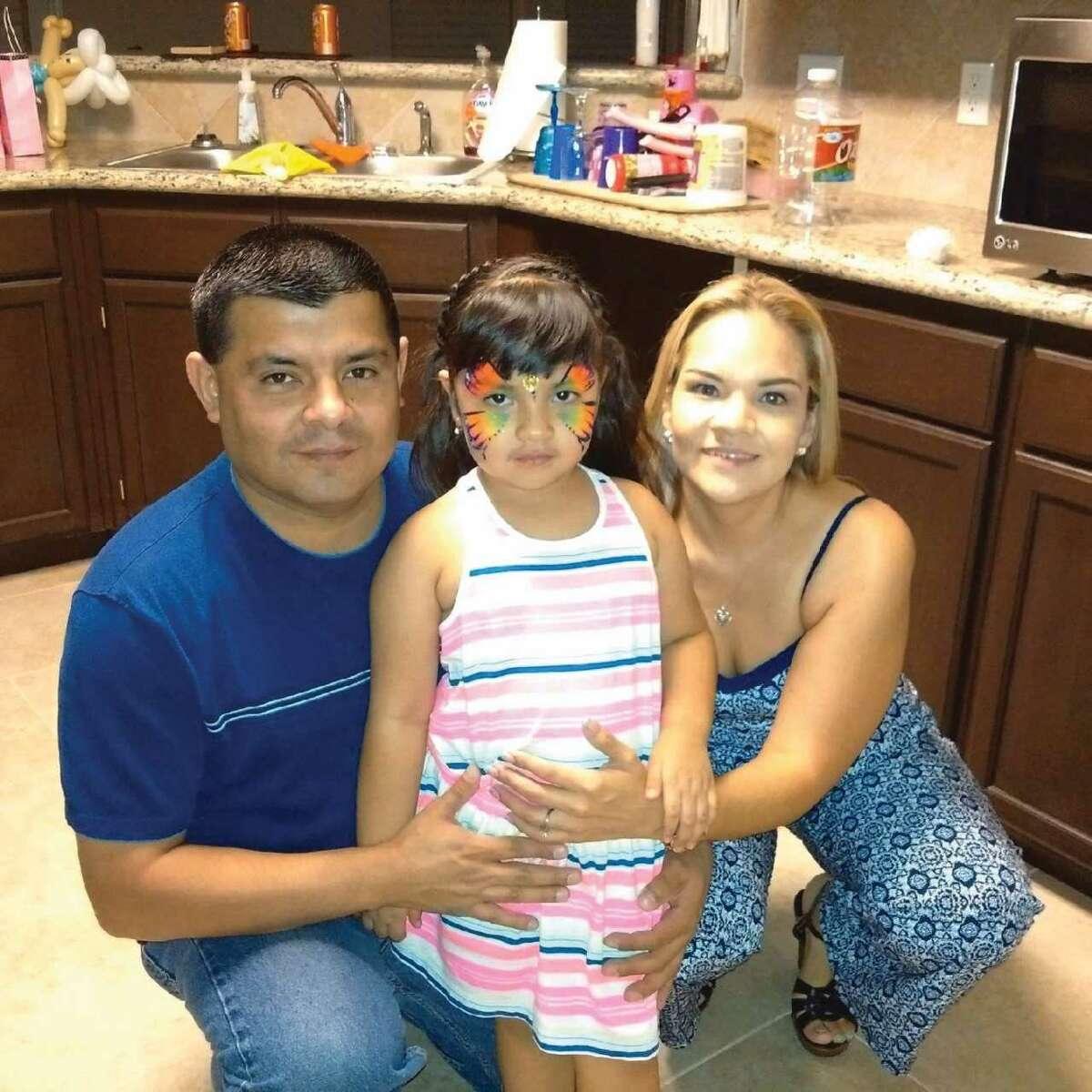 Laredo Morning Times MIS Director Michael Robert Castillo, left, is pictured with his wife, Maribel Castillo, and daughter Victoria Kristelle Castillo.
