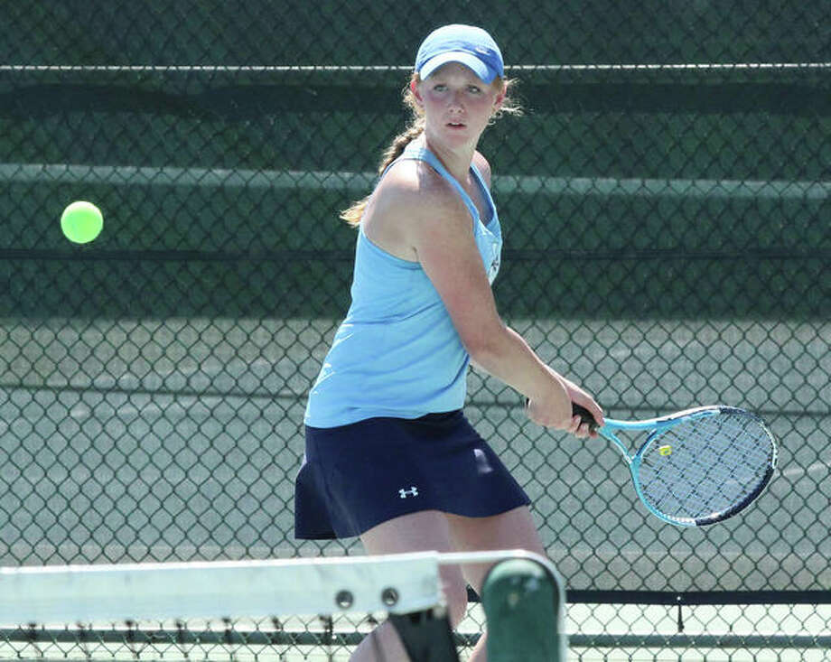 Jersey's Hannah Hudson, shown playing Saturday in the Robert Logan Invitational at LCCC's Andy Simpson Tennis Complex in Godfrey, was back home at Jerseyville on Tuesday and earned a hard-fought win at No. 1 singles against Marquette Catholic.