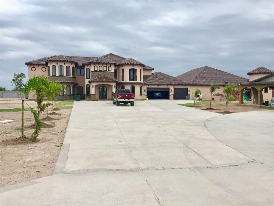 A 10,507-square-foot Laredo home with an indoor swimming pool is on the market for $1.5 million. Photo: Courtesy Nery O. Torres