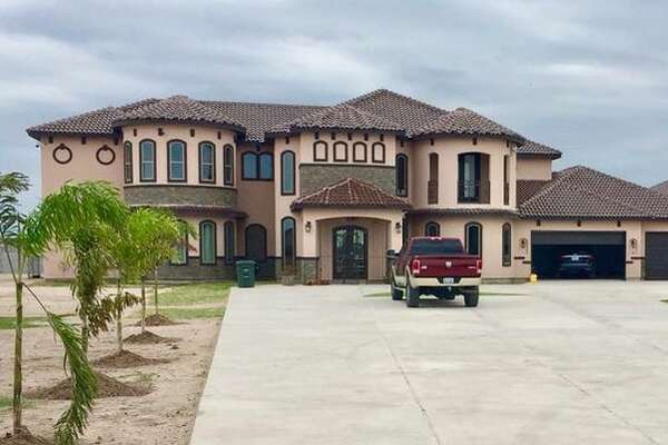 A 10,507-square-foot Laredo home with an indoor swimming pool is on the market for $1.5 million.