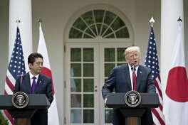 President Donald Trump speaks as Shinzo Abe, Japan's prime minister, left, listens in the Rose Garden of the White House in Washington on June 7, 2018.