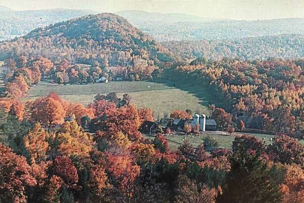 This is the 1950s postcard that inspired Lorraine Ryan's recent paintings of the scenic overlook on Route 67 in New Milford.