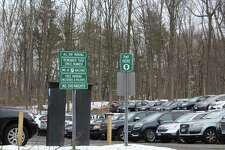In June, 38 spots were changed from metered parking spaces to permit only spaces at Talmadge Hill Road parking lot.