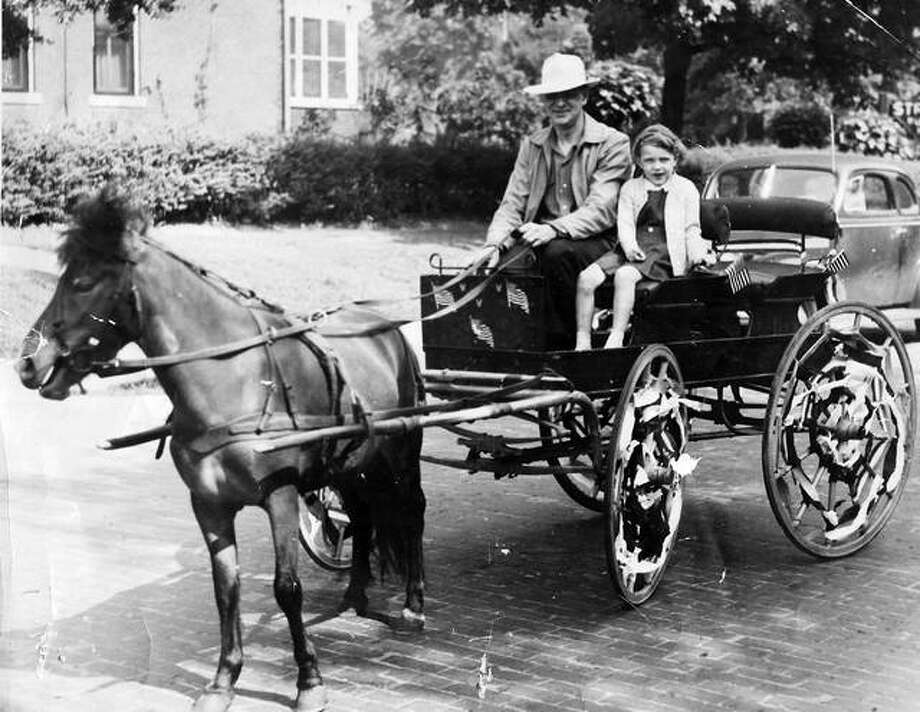 Father Walter Renken Sr. and his daughter Harriette in the Alton Memorial Day Parade, some time between 1946 and 1947. Photo: File Photo