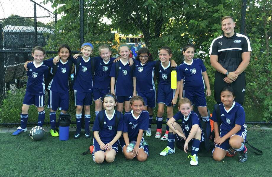 The Wilton White Girls U10 soccer team poses for a photo after a game recently. Players include, kneeling from left, Mia Timnev, Abby Philippon, Abby Savage, Caitlyn Tsai, and standing, from left, Katie Cosentino, Gaby Torres, Harper Crawford, Naomi Cronley, Taryn Czick, Katie Mesh, Madison Pendergast, Isla Dzik, and Coach Spencer Overbeeke. Photo: Contributed Photo