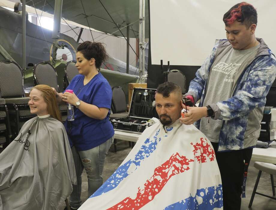 Mercedez Acosta preps Jessica Mitchell's hair as Juan Mendez trims Shawn Isaac 09/19/18 at the West Texas VA Health Care System Stand Down event for area veterans. Students from the Midland College cosmetology and barber schools were ready to provide veterans trims and new styles. Tim Fischer/Reporter-Telegram Photo: Tim Fischer/Midland Reporter-Telegram