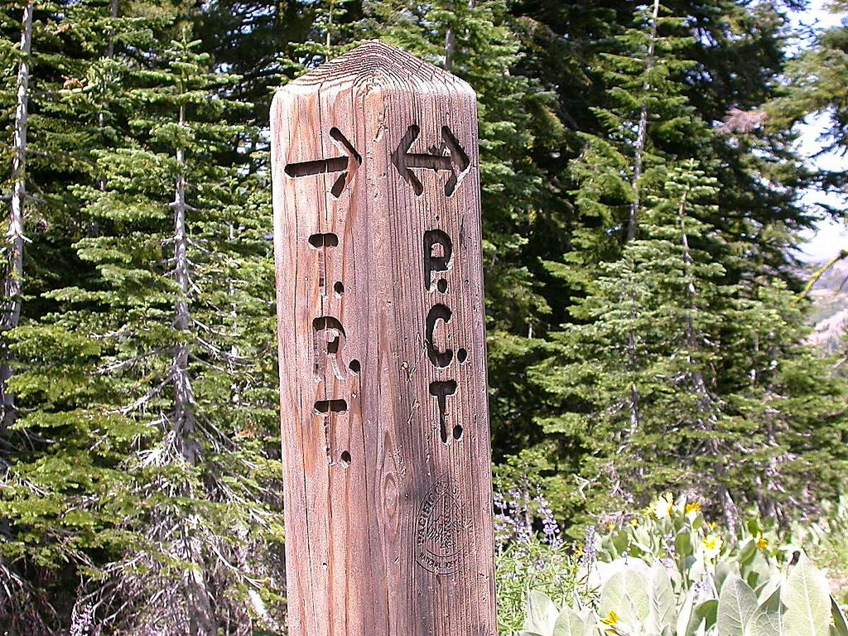A signed junction of the Tahoe Rim Trail and Pacific Crest Trail in the Granite Chief Wilderness