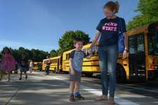 """Sarah Fasano and her preschool son James Fasano arrive at Miller Driscoll to the first day of school, Sept. 4. Wilton Public Schools has partnered with the Wilton Youth Council to offer parents a six-week workshop called """"How to Talk So Kids Will Listen and Listen So Kids Will Talk."""""""