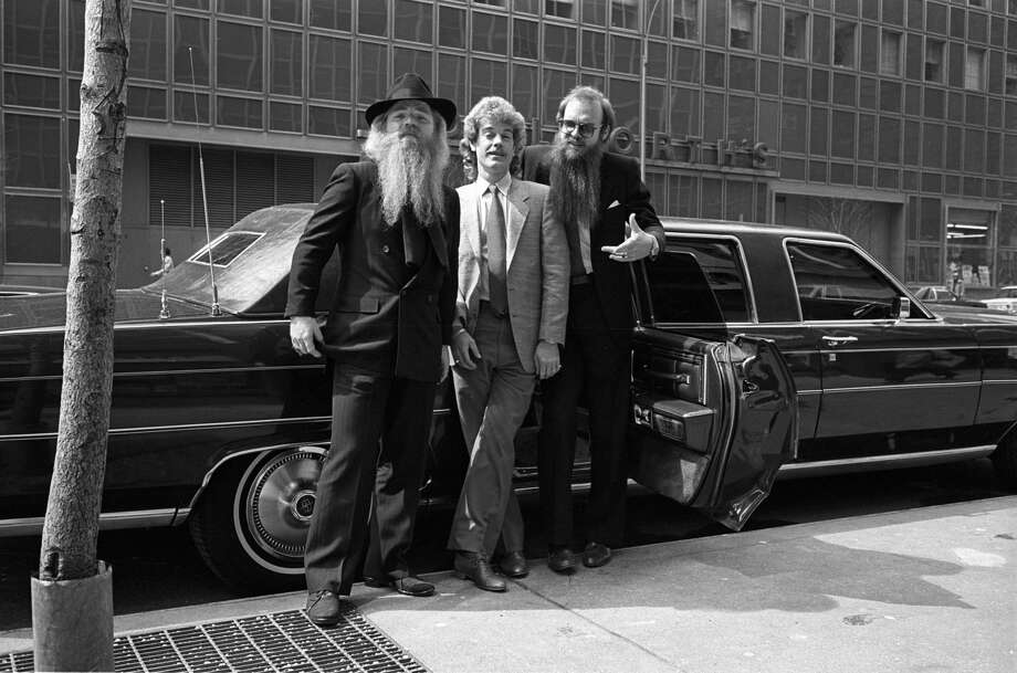 ZZ Top hangs out next to a stretched limousine in the '80s. Photo: Richard E. Aaron/Redferns
