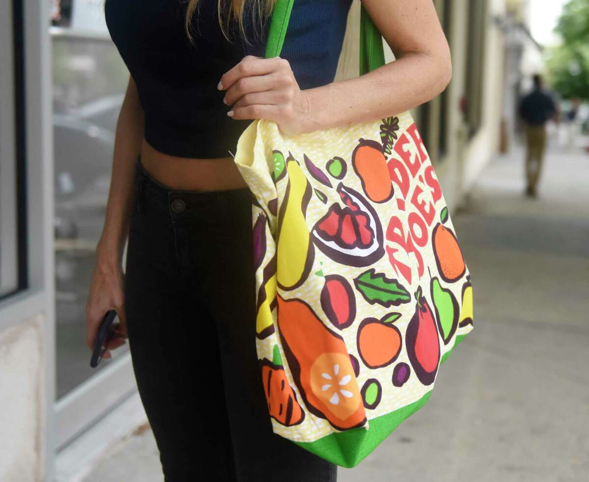 New Canaan resident Diane Raso carries items in a reusable bag in downtown Greenwich, Conn. Wednesday, Sept. 19, 2018. Stores and customers have had mixed reactions since the plastic bag ban was implemented in Greenwich on Wednesday Sept. 12.