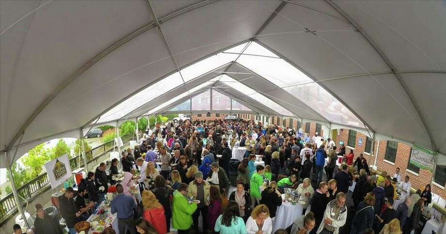 A crowd gathers under the tent at Taste of Fairfield Photo: Contributed