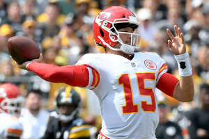 Chiefs QB Patrick Mahomes, who has thrown an NFL-record 10 touchdown passes in the first two weeks, is a former college teammate of UAlbany's Vince Testaverde. (Don Wright/Associated Press)