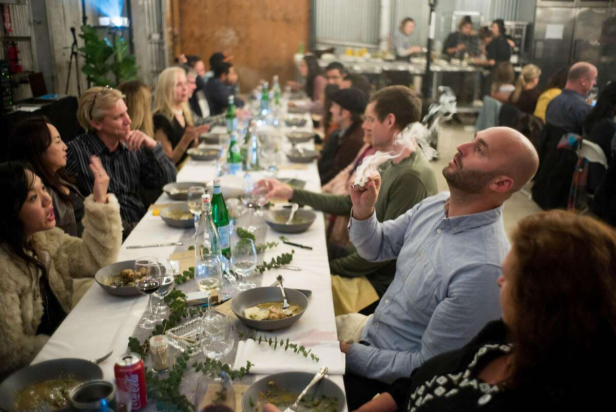 Michael Ray smokes a joint during a Cannaisseur dinner in San Francisco, Calif. on Saturday, Sept. 16, 2018. Cannaisseurs blends cannabis and fine dining for a unique experience.