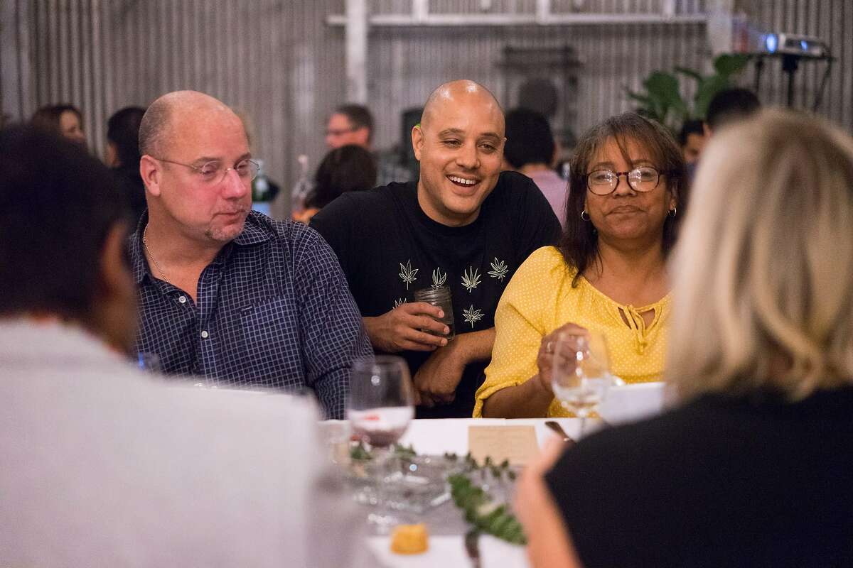Ryan Bush, center, talks to Cannaisseur diners in San Francisco, Calif. on Saturday, Sept. 16, 2018. Cannaisseurs blends cannabis and fine dining for a unique experience.