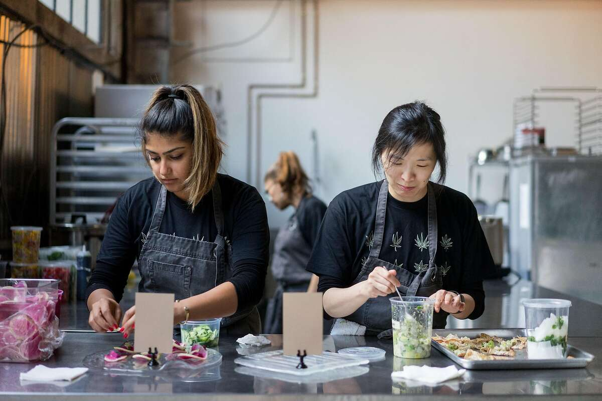 Ajinder Plahey, left, and Mandy Morris plate appetizers during a Cannaisseur dinner in San Francisco, Calif. on Saturday, Sept. 16, 2018. Cannaisseurs blends cannabis and fine dining for a unique experience.