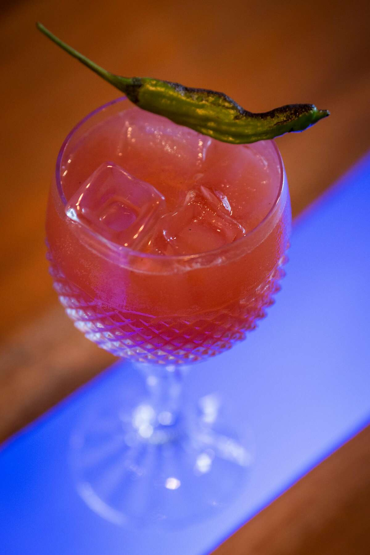 Copper Spoon co-owner/bartender Vita Simone demonstrating how to make the Loyalty cocktail, Wednesday 12 September 2018 in Oakland, CA. Loyalty - watermelon shrub, shishito honey syrup, fresh lime juice, 50mg Purium CBD oil soda water with a blistered shishito garnish.