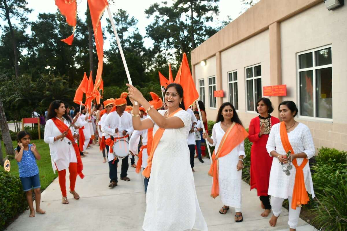 Aishwarya Deshpande swings a flag at a prior Ganesh festival at The Hindu Temple of The Woodlands.