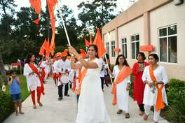 Aishwarya Deshpande swings a flag at a prior Ganesh festival at The Hindu Temple of The Woodlands.