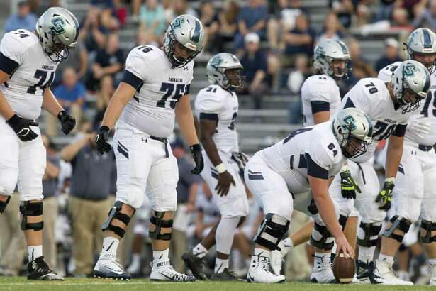 Members of the College Park offensive line are seen during the first quarter of a District 15-6A high school football game at Buddy Moorhead Stadium Friday, Sept. 14, 2018, in Conroe.