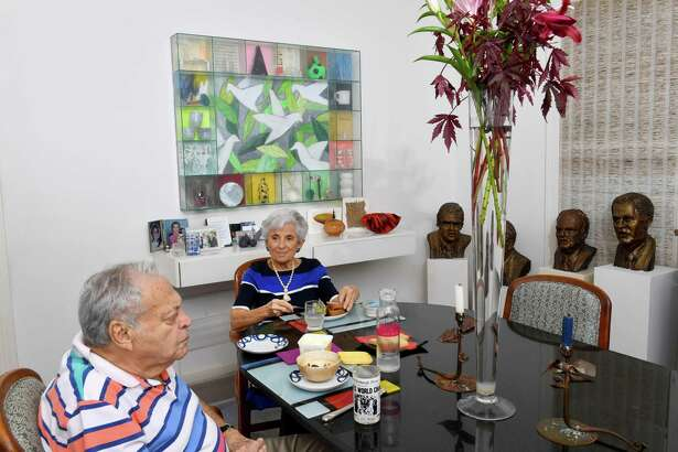 Art collector and artist Jane Mason, 90, lunches with her husband, Arthur, 94, beside the busts she sculpted of the main players in Watergate. The Masons are shown Sept. 17, 2018, at their home in Washington.
