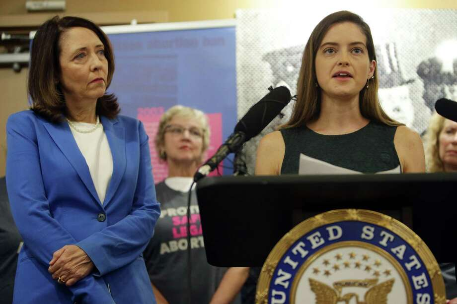 Sexual assault survivor Caitlin Flynn speaks alongside U.S. Senators Patty Murray and Maria Cantwell, left, who gave a joint statement in support of Dr. Christine Blasey Ford who has accused Trump Supreme Court nominee Brett Kavanaugh of attempted rape, Wednesday, Sept. 19, 2018 at Planned Parenthood. Both Senators demand an FBI investigation into Ford's allegations. Photo: GENNA MARTIN, SEATTLEPI.COM / SEATTLEPI.COM