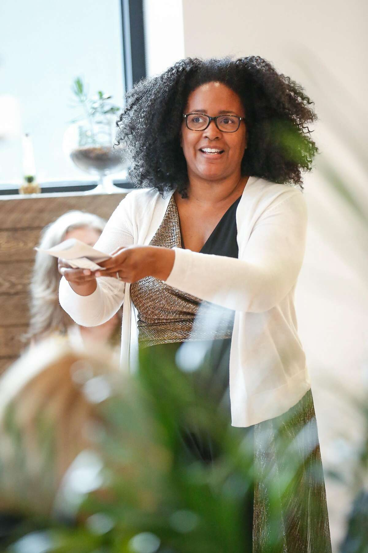 Ren� Jones, cofounder of Triple Apex, talks about her product to a group of women on Wednesday, July 25, 2018 in San Francisco, California. Ellementa organizes gatherings for women to share stories and experiences with cannabis and CBD and learn from experts in the field and discover new products.