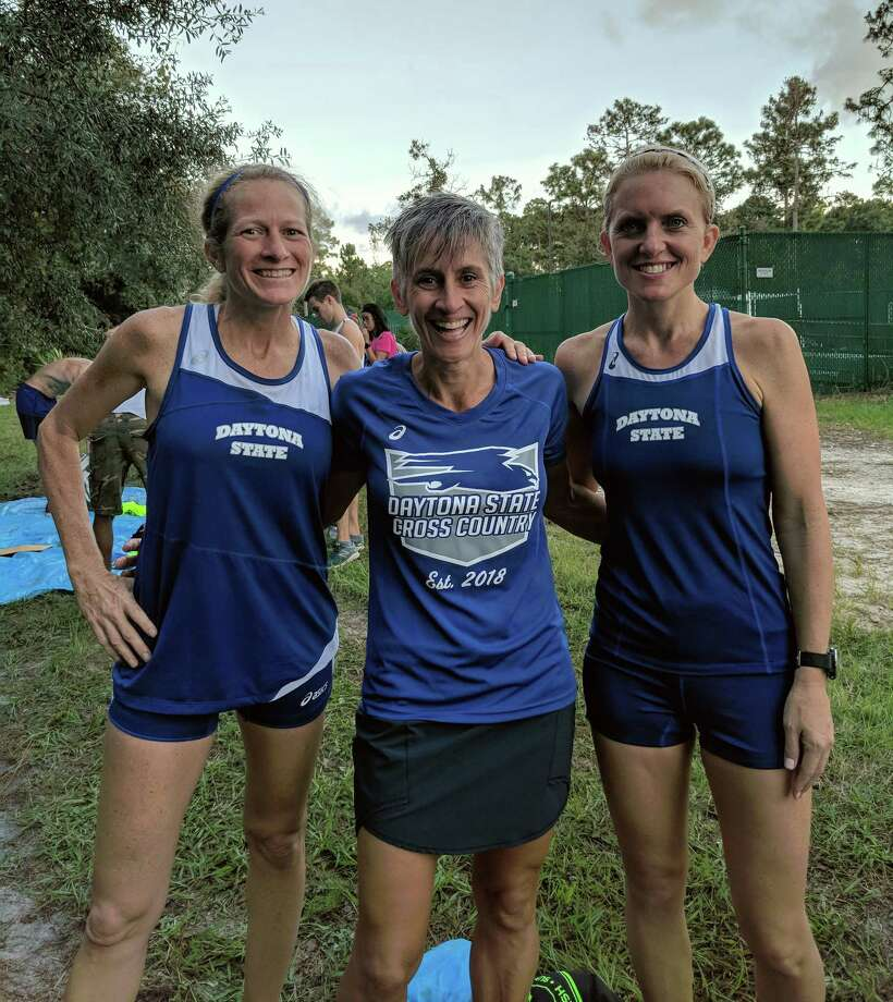 Kris Gray, 49, Bego Lopez, 50, and Jenny Eslin, 42, pose after one of the inaugural meets for the Daytona State College cross-country team. Photo: Photo Courtesy Of Daytona State College. / The Washington Post