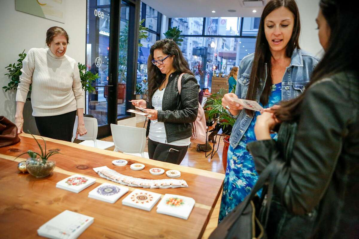 Participants (left to right) Nannette Eaton, Melina Baeza, Jen Dekok, and Christine Martinez discuss cannabis-infused herbal tea on Wednesday, July 25, 2018 in San Francisco, California. Ellementa organizes gatherings for women to share stories and experiences with cannabis and CBD and learn from experts in the field and discover new products.