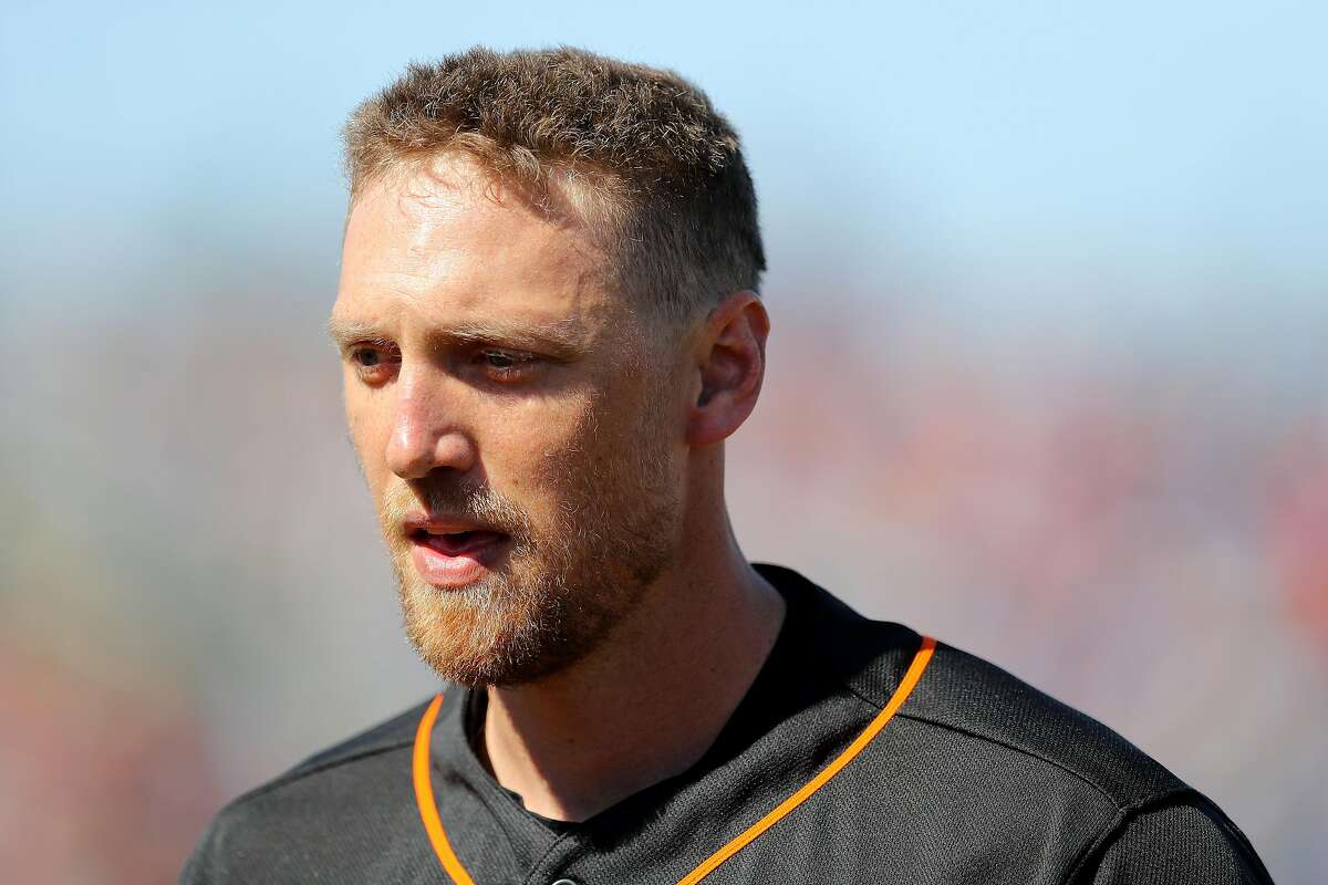 FILE: Hunter Pence #8 of the San Francisco Giants walks to the dugout during a game against the Chicago Cubs on Sunday, February 25, 2018 at Scottsdale Stadium in Scottsdale, Arizona. (Photo by Alex Trautwig/MLB Photos via Getty Images)