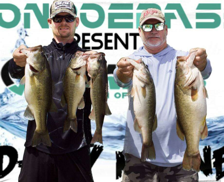 Tim and Evan Carlson came in first place in the CONROEBASS/CASTAWAY Mid-Day Madness Tournament with a stringer total weight of 24.06 pounds. Photo: Conroe Bass