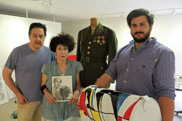 From left, Ben, Susan and Alex Guerrero work on an exhibit at the New Canaan Historical Society spotlighting the photographs of Pedro Guerrero, Ben and Susan's father.