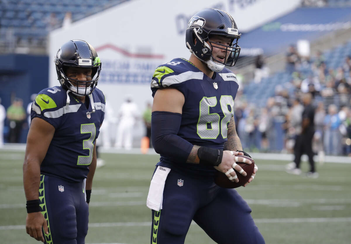Center Justin Britt (pictured) and wide receiver Paul Richardson came to the VMAC Wednesday for tryouts with the team, according to the league's transaction wire. Seattle selected Richardson and Britt 45th and 64th, respectively, in the '14 draft.