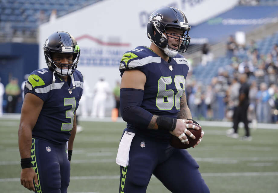 Center Justin Britt (pictured) and wide receiver Paul Richardson came to the VMAC Wednesday for tryouts with the team, according to the league's transaction wire. Seattle selected Richardson and Britt 45th and 64th, respectively, in the '14 draft. Photo: Elaine Thompson/Associated Press