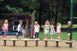 Children climb on the new playground at the Methodist Family Center Preschool in Darien. The Rev. Thomas Kim led the ribbon-cutting celebration on Sept. 9 with a blessing of the playground and songs of celebration.