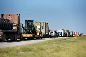 Trucks sit in traffic on Highway 302 near Kermit, Texas, U.S., on Friday, Aug. 24, 2018. In the often upside-down world of West Texas, the biggest problem with building more roads is not the physical cost of the materials, but a lack of available workers and affordable housing. It's tough to match the high pay offered in the oilfields. Photographer: Callaghan O'Hare/Bloomberg