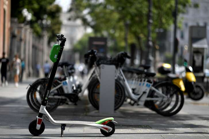 A picture shows an electric scooter of the Lime-S electric scooter-sharing service in Madrid on September 5, 2018. (Photo by GABRIEL BOUYS / AFP)GABRIEL BOUYS/AFP/Getty Images