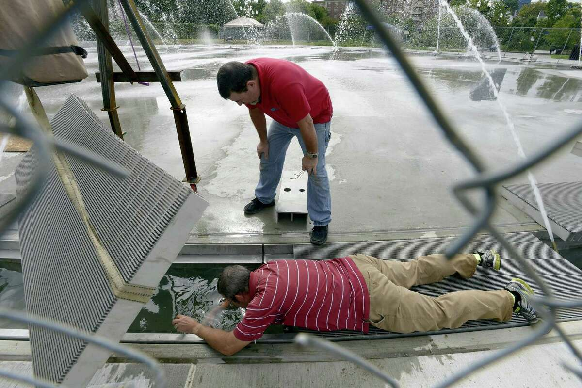Scott Johnston, Co-Owner of Delta Fountians, Jacksonville, Florida works on one of six zones of the new fountain at Mill River Park on Thursday, Sept. 13, 2018 in Stamford, Connecticut.. The fountain, which will also serve as an ice rink in the winter, is schedule to open next week. Johnston's company also help design the fountains at the World Trade Center memorial.