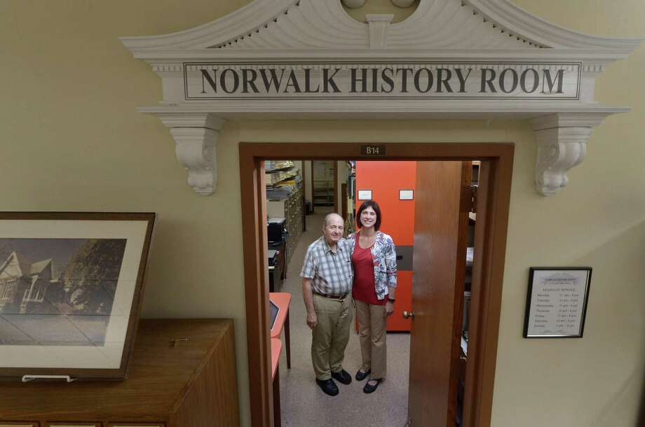 Norwalk Library volunteer Ralph Bloom and archivist Lynn Hildebrand in the basement level Norwalk History Room Tuesday, September 18, 2018, in Norwalk, Conn. This Sunday, Norwalk Library will celebrate the 5th anniversary of its History Room with a reception featuring High Tea, a photo exhibit of Norwalk History, the newly digitized Norwalk Hour, and talks from Norwalk history authors and citizen researchers. Photo: Erik Trautmann / Hearst Connecticut Media / Norwalk Hour