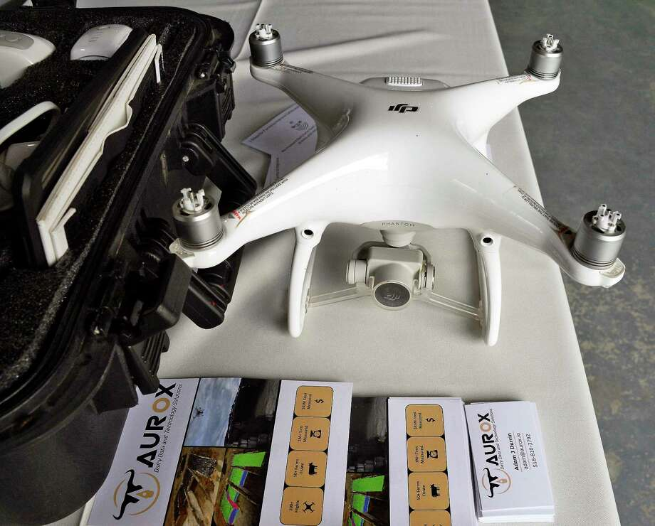 A drone used to accurately measure and track animal feed to save farms money & improve safety on display during a Saratoga County Prosperity Partnership luncheon at the Ellms Family Farm Wednesday Sept. 19, 2018 in Ballston, NY.  (John Carl D'Annibale/Times Union) Photo: John Carl D'Annibale, Albany Times Union / 20044871A