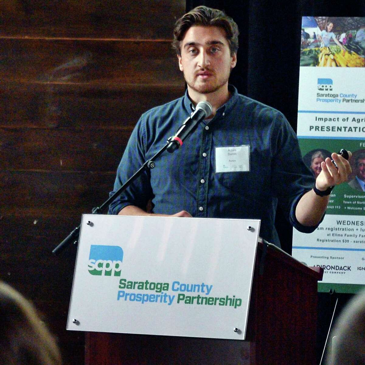 Adam Durrin of Aurox discusses the use of drones to accurately measure and track animal feed to save farms money & improve safety during a Saratoga County Prosperity Partnership luncheon at the Ellms Family Farm Wednesday Sept. 19, 2018 in Ballston, NY. (John Carl D'Annibale/Times Union)