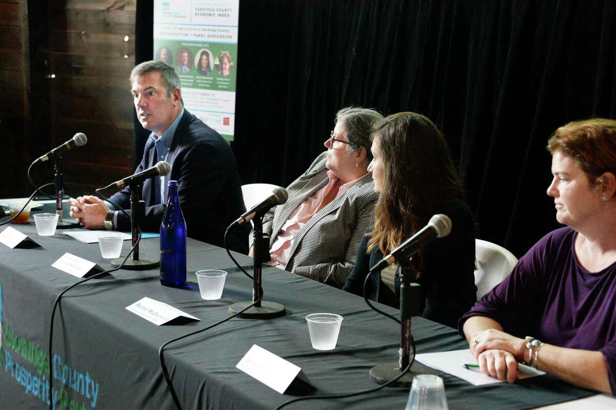 Panelists, from left, Bill Peck of Welcome Stock Farm and Supervisor Town of Northumberland, Assemblywoman Carrie Woerner, Rachel (Czub) McDermott of Whole Feeds of the Hudson Valley and Jennifer Koval of Koval Brothers Dairy in Stillwater, during a discussion at a Saratoga County Prosperity Partnership luncheon Wednesday Sept. 19, 2018 in Ballston, NY. (John Carl D'Annibale/Times Union)