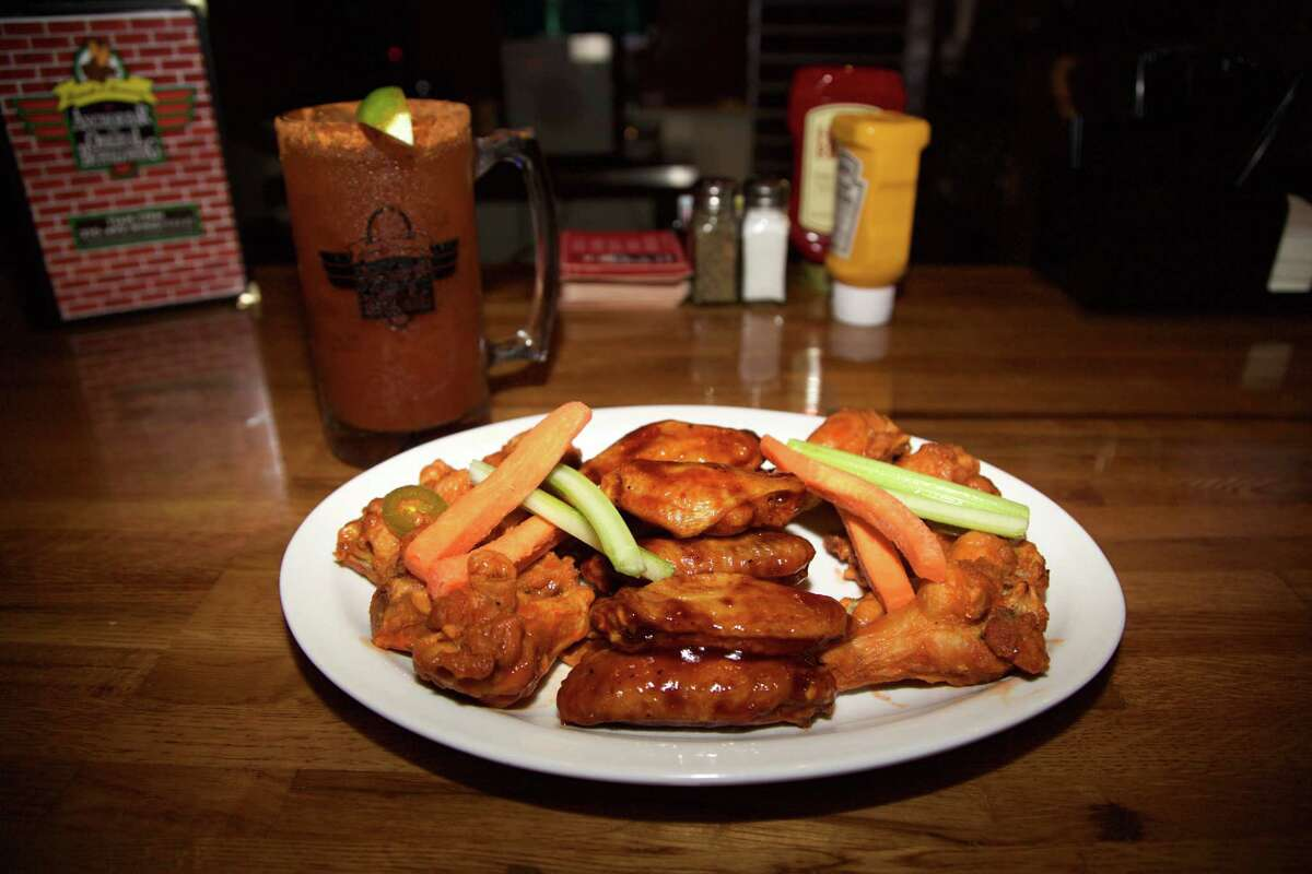 A beer paired with wings at Anchor Bar.