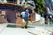 """WEBE 108's Jason Li rappels off the roof of the People's Bank tower during a preliminary run of the Wakeman Boys/Girls Club's """"Over the Edge"""" fundraiser in downtown Bridgeport, Conn., on Saturday, Sept. 15, 2018. In Saturday's preliminary event, Li and several other people from various companies and groups got a chance to rappel off the roof of the People's Bank tower. The main event is slated for Sunday with 76 slots available for full day rappelling starting at 9 a.m. and going until 5 p.m. Money raised by individuals and organizations from $500 to $3000 will support programs at the Wakeman Boys/Girls Club. According to the club's website $118,859 has been raised so far."""