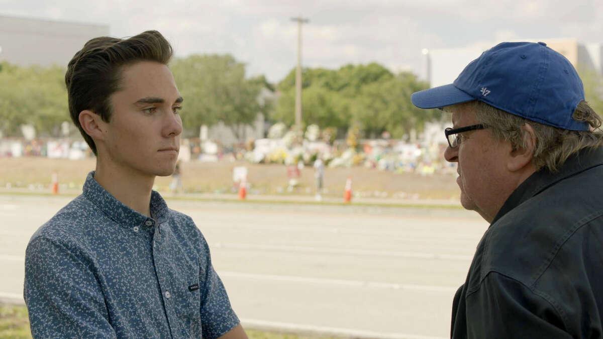 Filmmaker Michael Moore, right, interviews David Hogg, a survivor of the Parkland school shooting and a gun-control activist.