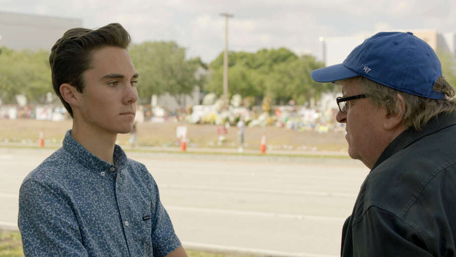 Filmmaker Michael Moore, right, interviews David Hogg, a survivor of the Parkland school shooting and a gun-control activist. Photo: Briarcliff Entertainment-GathrFilms / Briarcliff Entertainment-GathrFilms